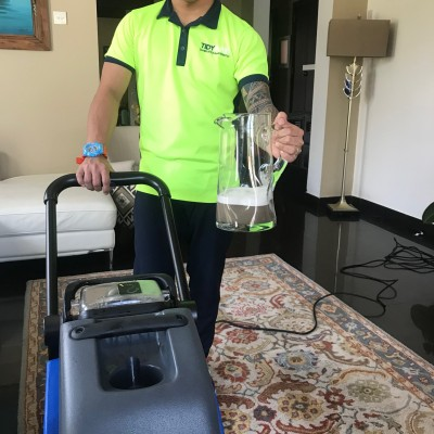 A man deep cleaning a room