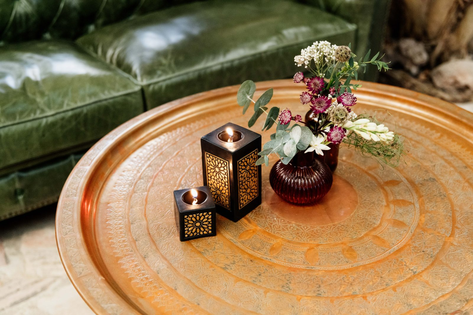 Flower and candle arrangement on Persian style table