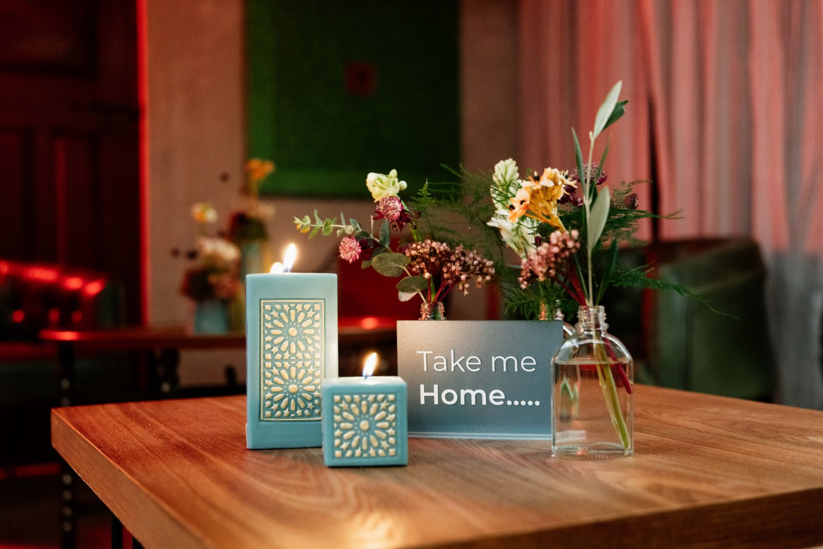 Wild flower and luxury candle arrangement on wooden table