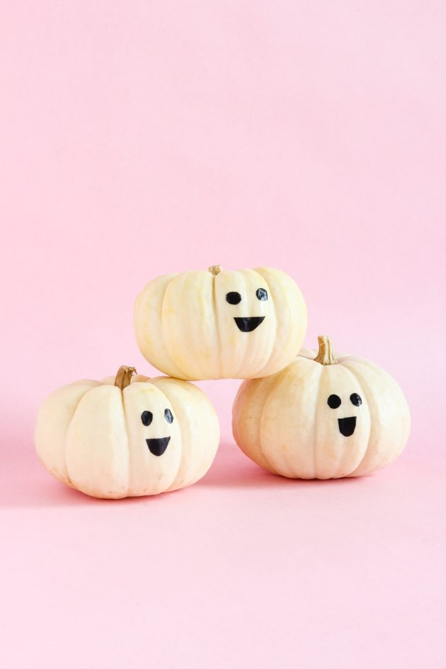 White pumpkins with stick on faces