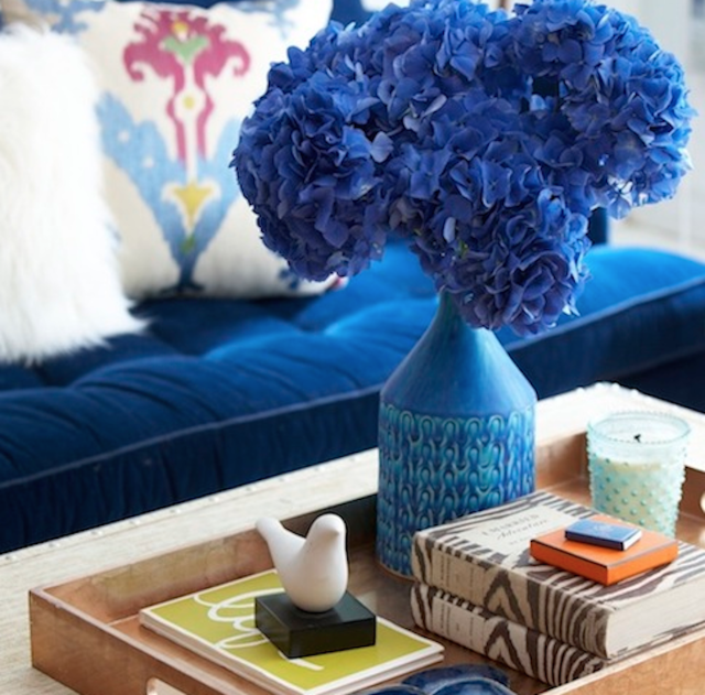 Coffee table with blue vase and flowers