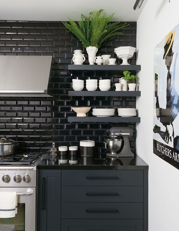 Kitchen with black subway tiles