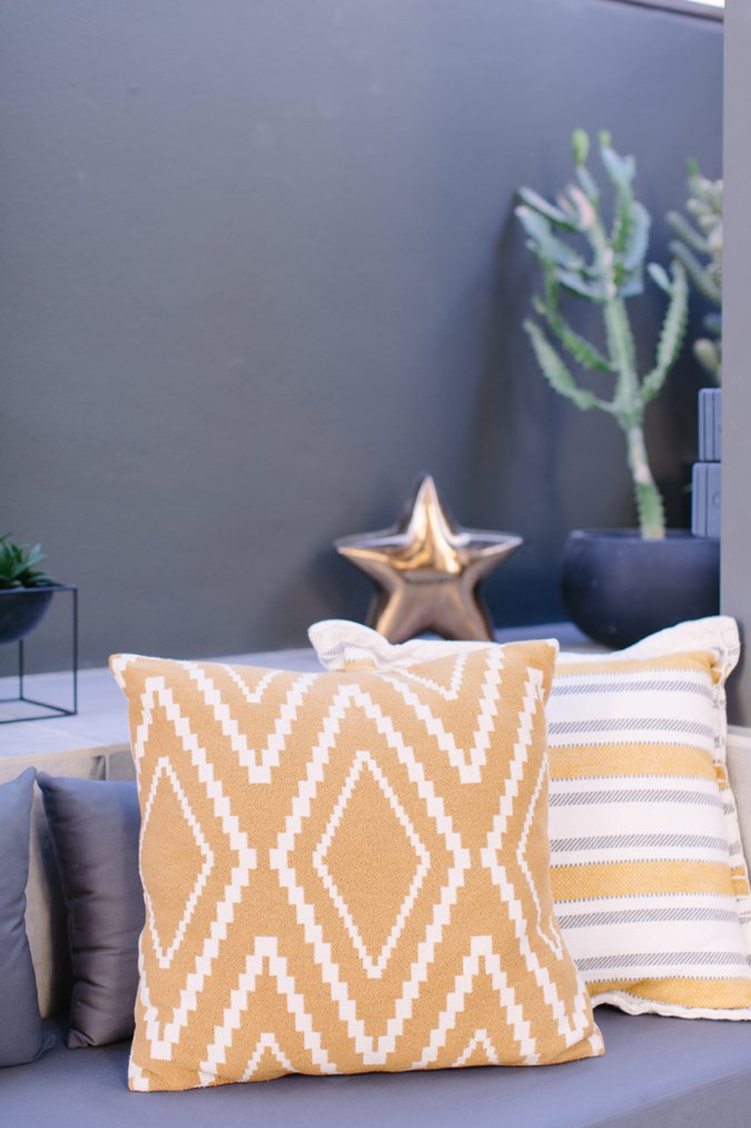 Mustard and grey garden cushions