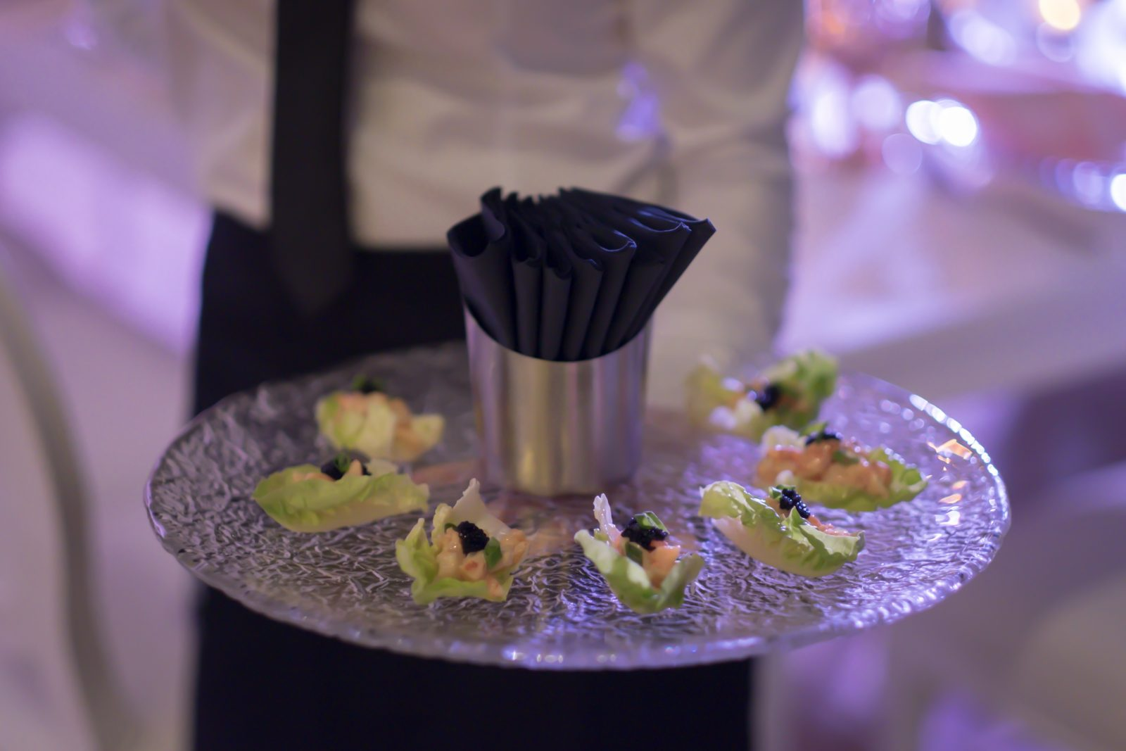 Canapés served on a glass tray