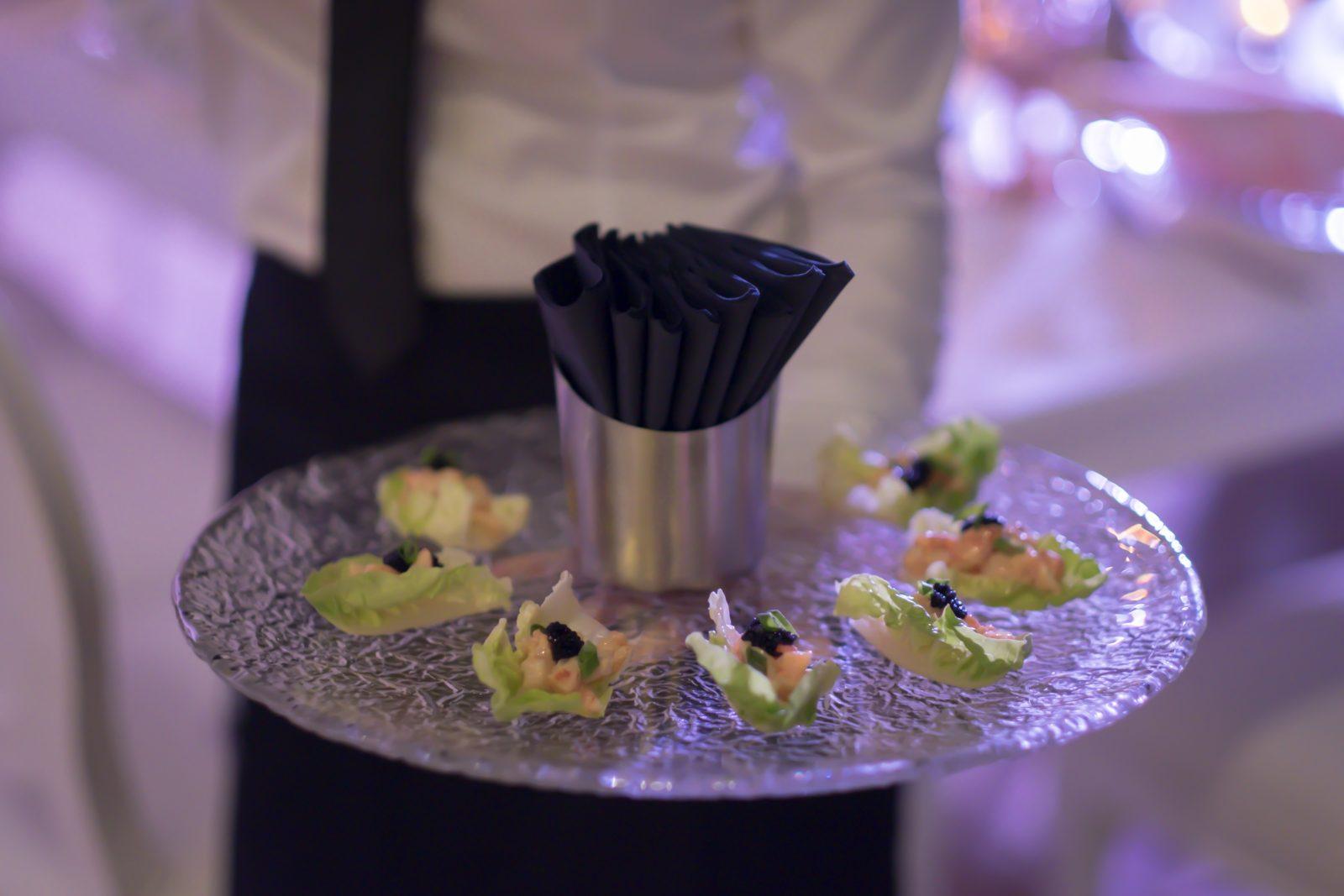 Canapés served on a glass tray