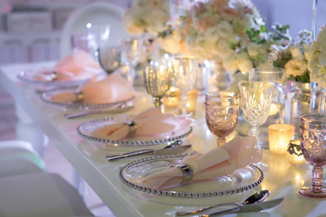Pink napkins with silver and glass plates