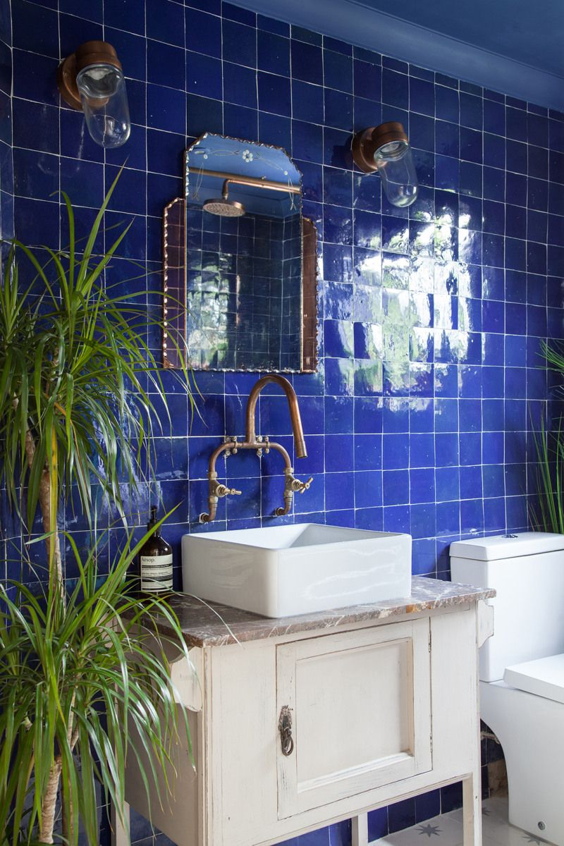 Blue tiles in bathroom with green plants