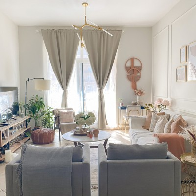 A living room filled with furniture by Vianne Khoury